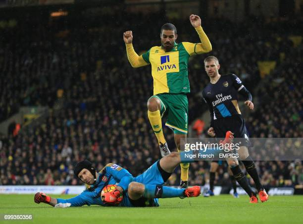 Arsenal goalkeeper Petr Cech saves at the feet of Norwich City's Lewis Grabban