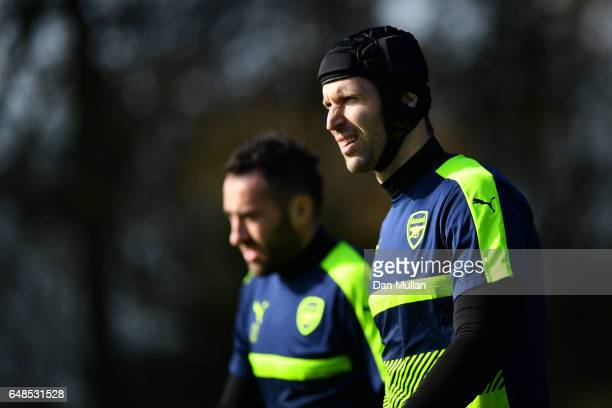 Arsenal goalkeepers Petr Cech and David Ospina arrive prior to the Arsenal traing session at London Colney on March 6 2017 in St Albans England