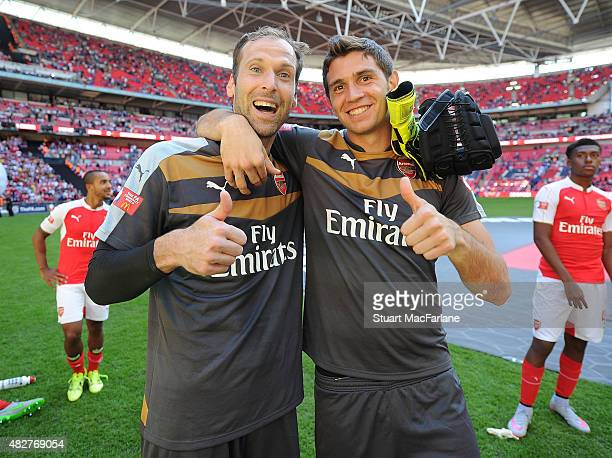 Arsenal goalkeepers Petr Cech and Emiliano Martinez celebrate after the FA Community Shield match between Chelsea and Arsenal at Wembley Stadium on...