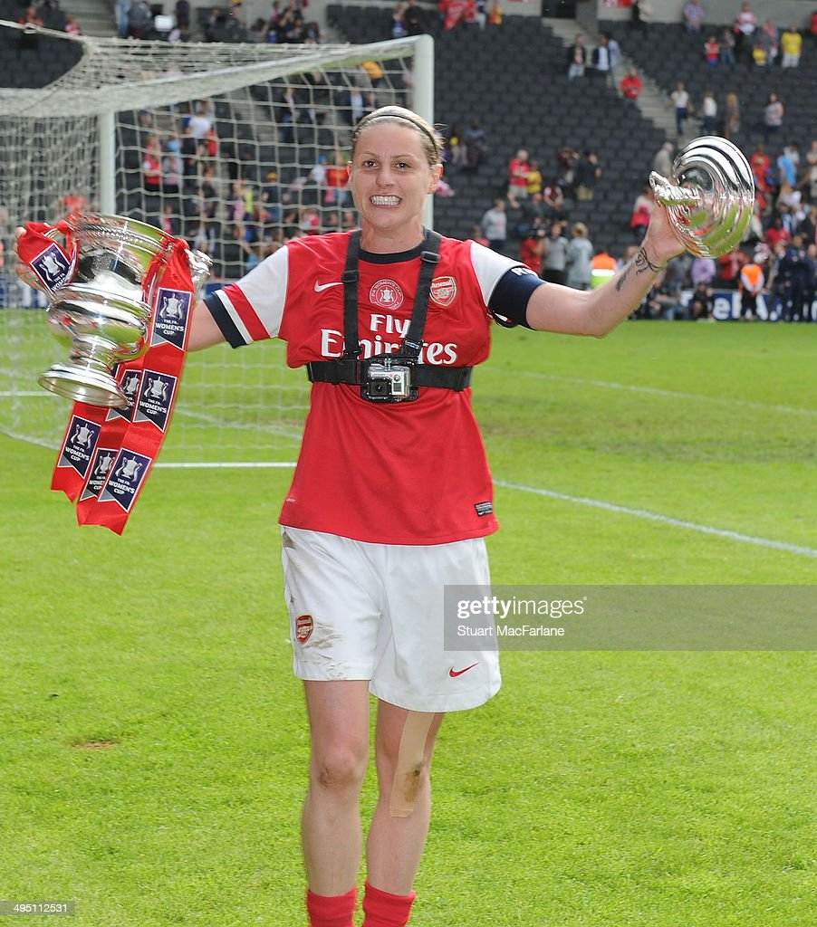 Arsenal goalscorer Kelly Smith celebrates Arsenal's FA Cup win after the match at Stadium mk on June 1, 2014 in Milton Keynes, England.