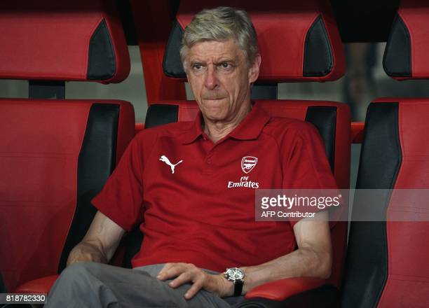 Arsenal head coach Arsene Wenger looks on during the International Champions Cup football match between Bayern Munich and Arsenal in Shanghai on July...