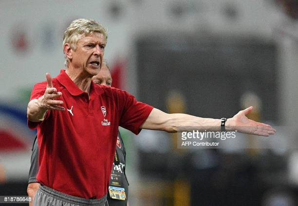 Arsenal head coach Arsene Wenger reacts during the International Champions Cup football match between Bayern Munich and Arsenal in Shanghai July 19...
