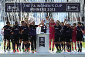 Arsenal Ladies FC player Kelly Smith lifts the trophy with captain Stephanie Houghton following the The FA Women's Cup Final between Bristol Academy...