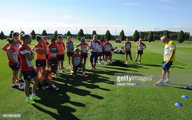 Arsenal Ladies Interim Coach John Bayer talks to the team before their training session at London Colney on July 3 2014 in St Albans England