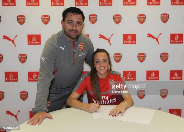 Arsenal Ladies latest signing Lisa Evans poses with Arsenal Ladies Manager Pedro Martinez Losa during a photocall at London Colney on May 16 2017 in...