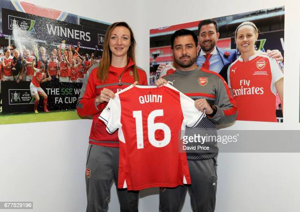 Arsenal Ladies latest signing Louise Quinn poses with Arsenal Ladies Manager Pedro Martinez Losa at London Colney on May 3 2017 in St Albans England