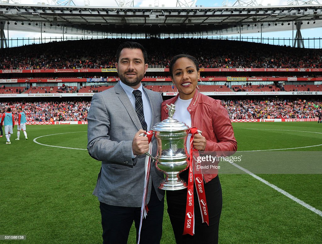 Arsenal Ladies Manager Pedro Martinez Losa and Alex Scott with the Womens FA Cup Trophy during half time of the Barclays Premier League match between...