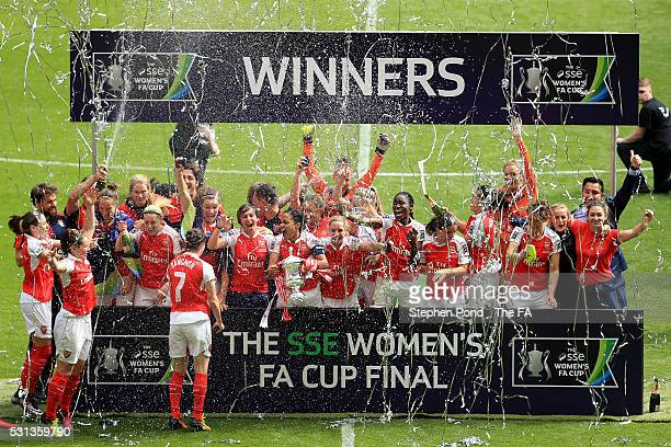 Arsenal Ladies' players celebrate with the trophy after victory in the SSE Women's FA Cup Final match between Arsenal Ladies and Chelsea Ladies at...
