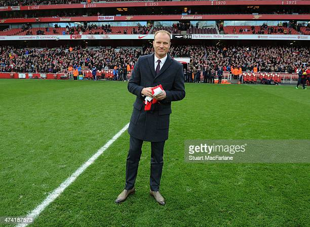 Arsenal legend Dennis Bergkamp waves to the fans at half time during the Barclays Premier League match between Arsenal and Sunderland at Emirates...