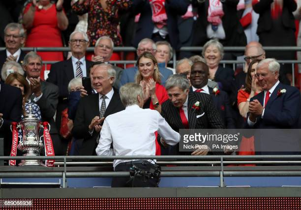 Arsenal majority owner Stan Kroenke shakes hands with manager Arsene Wenger after the final whistle during the Emirates FA Cup Final at Wembley...