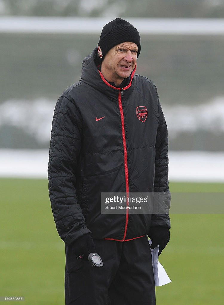 Arsenal manager Arsenal Wenger looks on during a training session at London Colney on January 22, 2013 in St Albans, England.