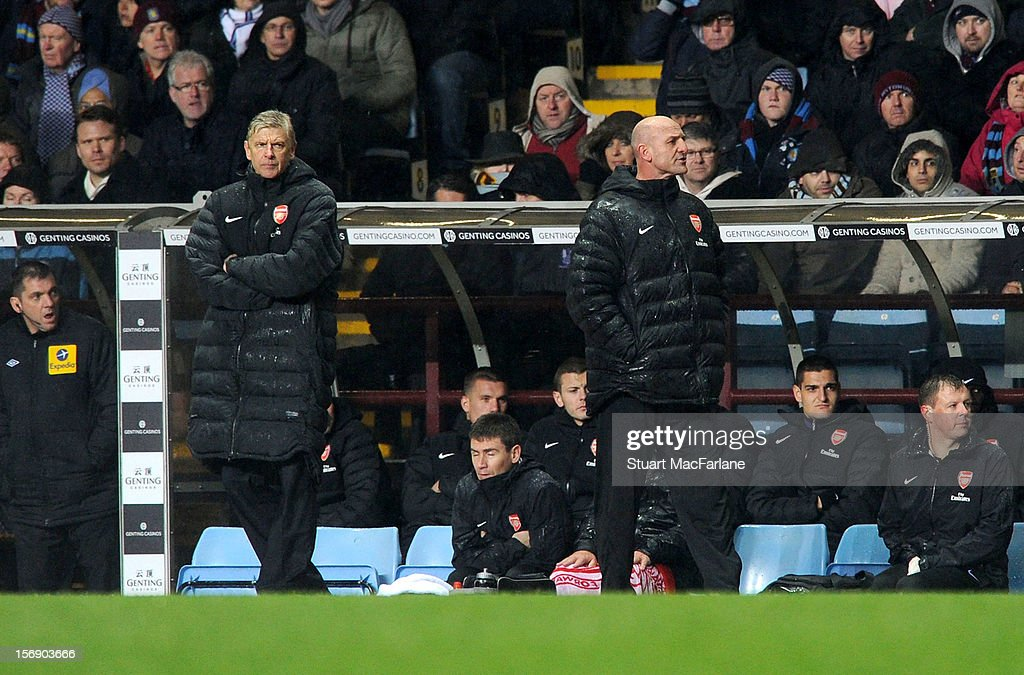 Arsenal manager Arsene Wenger and assistant Steve Bould during the Barclays Premier League match between Aston Villa and Arsenal at Villa Park on November 24, 2012 in Birmingham, England.
