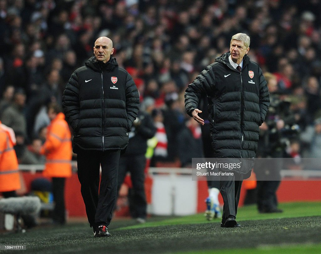Arsenal manager <a gi-track='captionPersonalityLinkClicked' href=/galleries/search?phrase=Arsene+Wenger&family=editorial&specificpeople=171184 ng-click='$event.stopPropagation()'>Arsene Wenger</a> and assistant Steve Bould during the Barclays Premier League match between Arsenal and Manchester City at Emirates Stadium on January 13, 2013 in London, England.