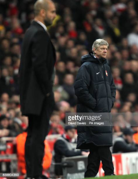 Arsenal manager Arsene Wenger and Barcelona manager Josep Guardiola on the touchline