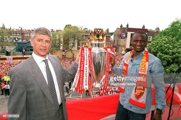 Arsenal manager Arsene Wenger and captain Patrick Vieira hold the Premier League trophy at Islington Town Hall on May 19 2004 in London England