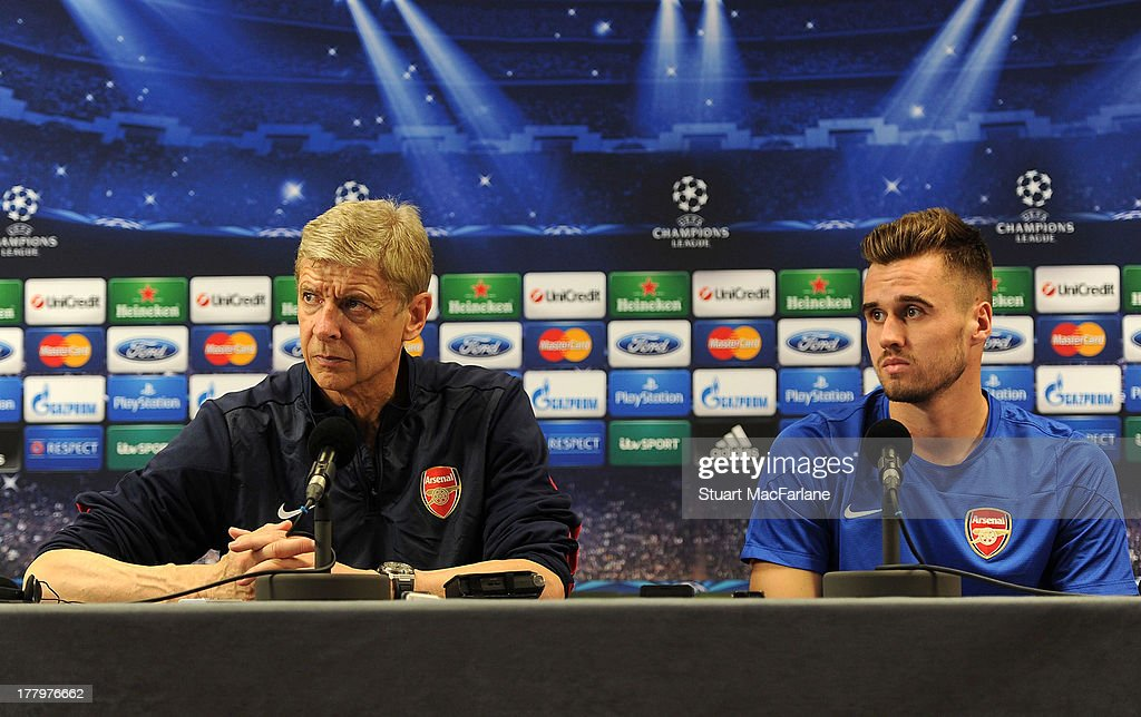 Arsenal manager <a gi-track='captionPersonalityLinkClicked' href=/galleries/search?phrase=Arsene+Wenger&family=editorial&specificpeople=171184 ng-click='$event.stopPropagation()'>Arsene Wenger</a> and defender Carl Jenkinson attend a press conference ahead of their UEFA Champions League Play Off second leg match against Fenerbache at London Colney on August 26, 2013 in St Albans, England.