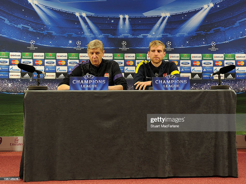 Arsenal manager Arsene Wenger and defender Per Mertesacker attend a press conference at London Colney on November 20, 2012 in St Albans, England.