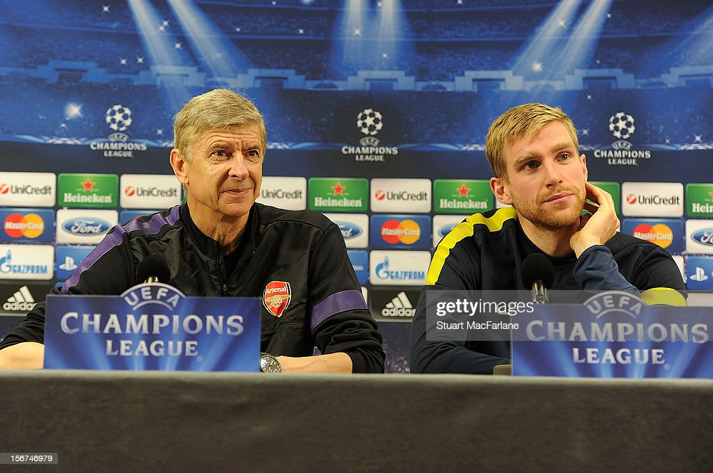 Arsenal manager Arsene Wenger and defender <a gi-track='captionPersonalityLinkClicked' href=/galleries/search?phrase=Per+Mertesacker&family=editorial&specificpeople=207135 ng-click='$event.stopPropagation()'>Per Mertesacker</a> attend a press conference at London Colney on November 20, 2012 in St Albans, England.