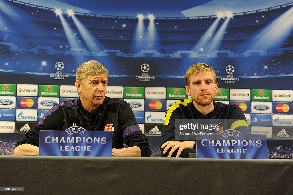 Arsenal manager Arsene Wenger and defender Per Mertesacker attend a press conference at London Colney on November 20, 2012 in St Albans, England.