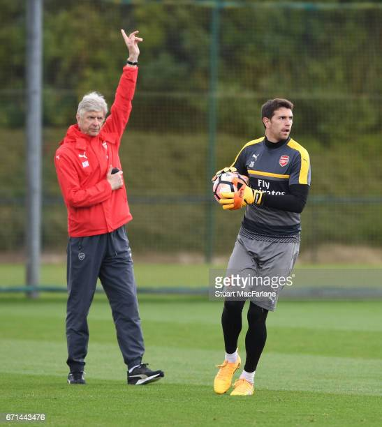 Arsenal manager Arsene Wenger and goalkeeper Emiliano Martinez during a training session at London Colney on April 22 2017 in St Albans England