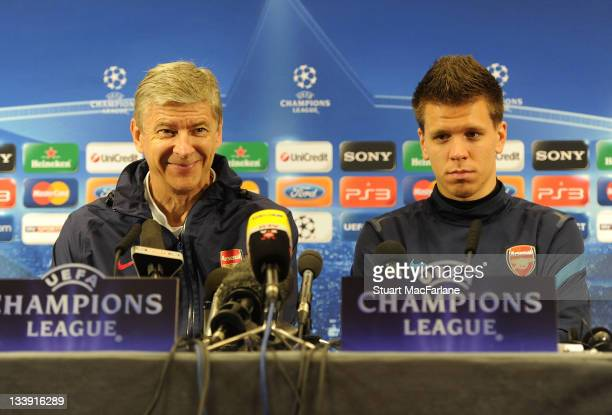 Arsenal manager Arsene Wenger and goalkeeper Wojciech Szczesny attend the pre match press conference ahead of their UEFA Champions League Group match...