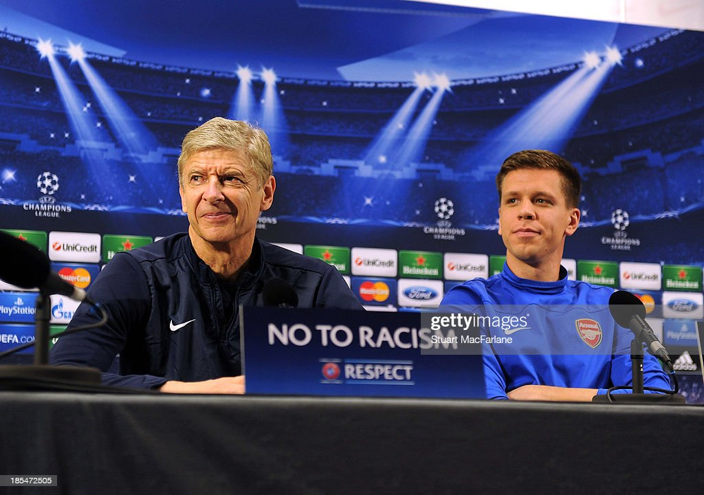 Arsenal manager <a gi-track='captionPersonalityLinkClicked' href=/galleries/search?phrase=Arsene+Wenger&family=editorial&specificpeople=171184 ng-click='$event.stopPropagation()'>Arsene Wenger</a> and goalkeeper <a gi-track='captionPersonalityLinkClicked' href=/galleries/search?phrase=Wojciech+Szczesny&family=editorial&specificpeople=6539507 ng-click='$event.stopPropagation()'>Wojciech Szczesny</a> attend a press confernece at London Colney on October 21, 2013 in St Albans, England.
