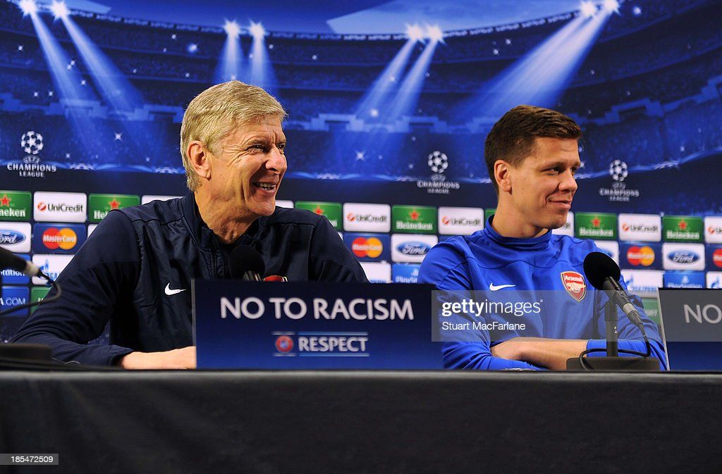 Arsenal manager Arsene Wenger and goalkeeper Wojciech Szczesny attend a press confernece at London Colney on October 21, 2013 in St Albans, England.