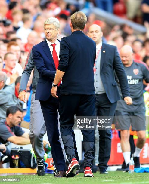 Arsenal manager Arsene Wenger and Liverpool manager Jurgen Klopp shake hands after the final whistle of the Premier League match at Anfield Liverpool