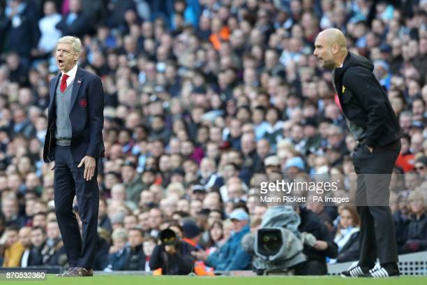 Arsenal manager Arsene Wenger and Manchester City manager Pep Guardiola during the Premier League match at the Etihad Stadium Manchester