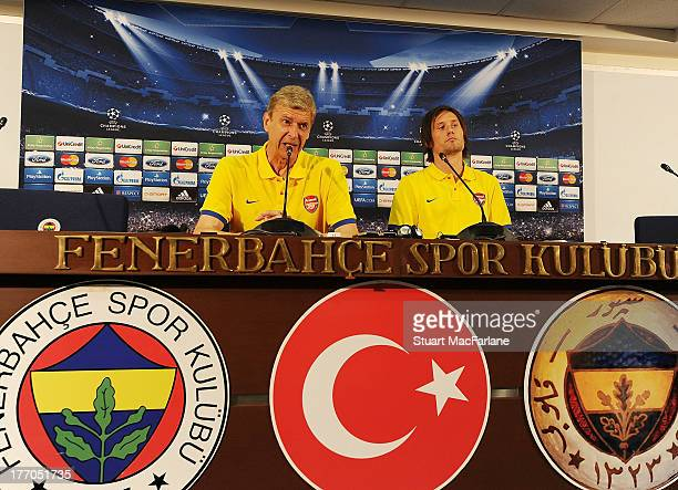 Arsenal manager Arsene Wenger and midfielder Tomas Rosicky during a Press Conference ahead of their UEFA Champions League Play Off match against...
