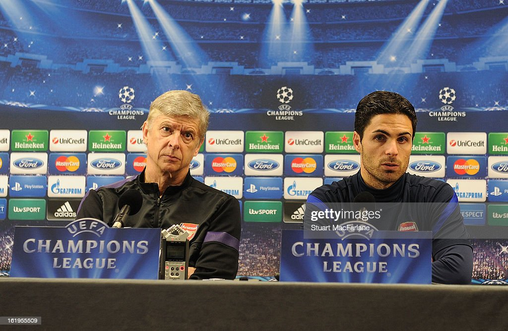 Arsenal manager Arsene Wenger (L) and Mikel Arteta attend a press conference ahead of their UEFA Champions League match against FC Bayern Muenchen at London Colney on February 18, 2013 in St Albans, England.