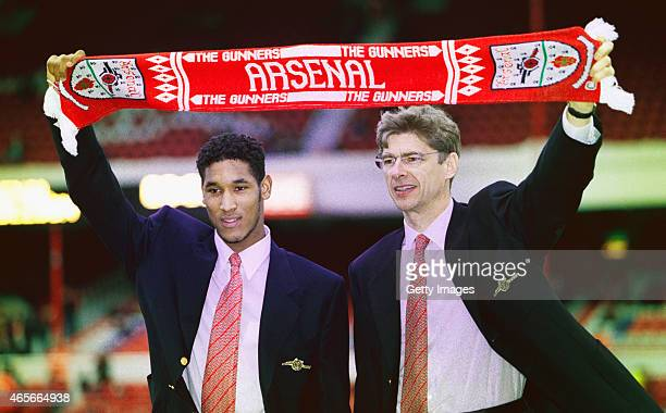 Arsenal manager Arsene Wenger and new signing Nicolas Anelka pictured before an FA Carling Premiership match between Arsenal and Wimbledon at...