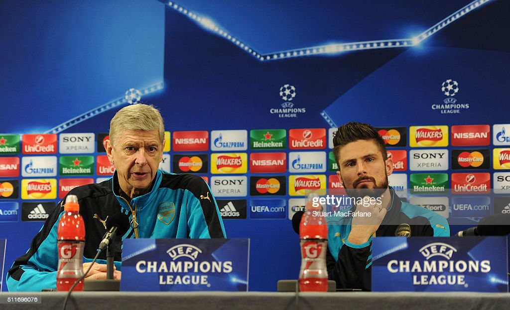 Arsenal manager Arsene Wenger and Olivier Giroud attend a press conference at London Colney on February 22, 2016 in St Albans, England.