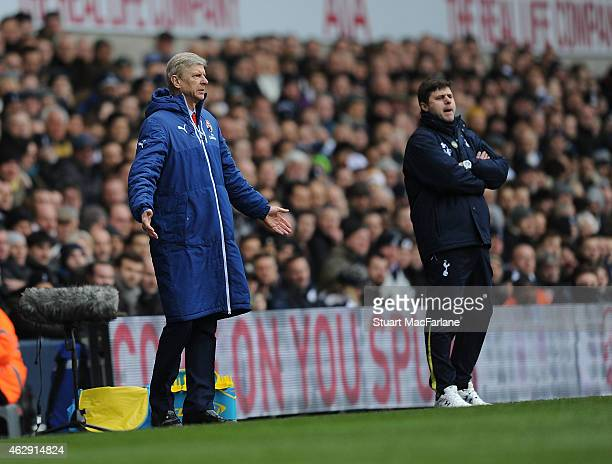 Arsenal manager Arsene Wenger and Tottenham Head Coach Mauricio Pochettino during the Barclays Premier League match between Tottenham Hotspur and...