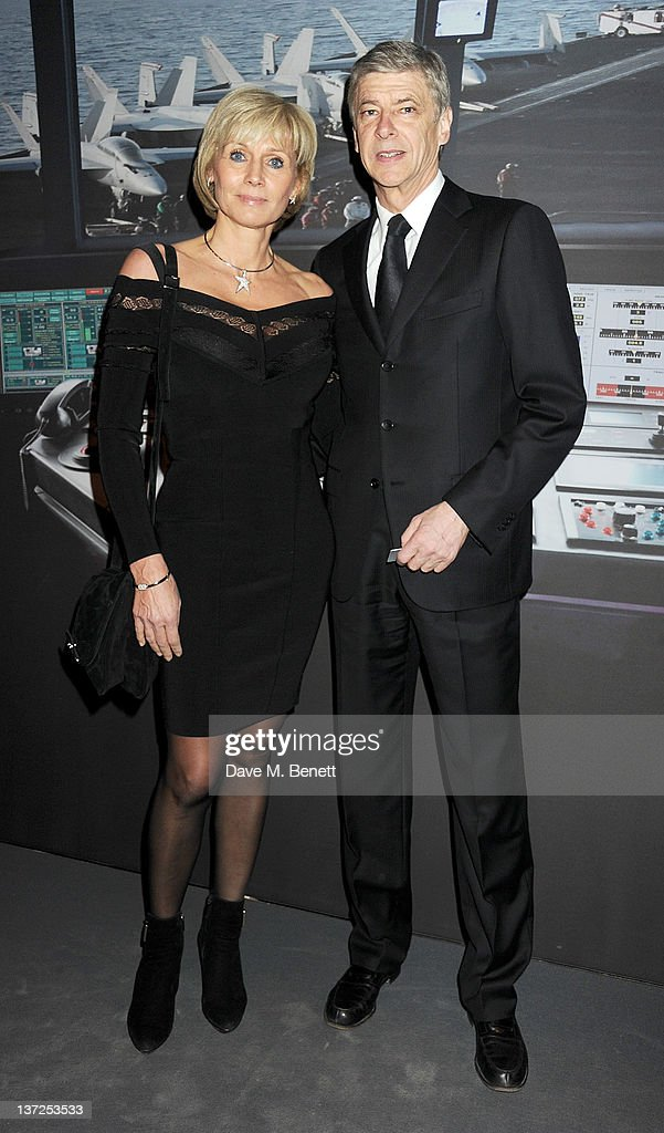 Arsenal Manager Arsene Wenger (R) and wife Annie Wenger attend the IWC Top Gun Gala Event at 22nd SIHH High Jewellery Fair on at the Palexpo Exhibition Hall January 17, 2012 in Geneva, Switzerland.