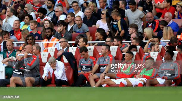 Arsenal manager Arsene Wenger appears dejected in the dugout