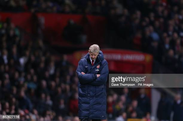 Arsenal manager Arsene Wenger appears dejected on the touchline just before halftime