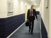 Arsenal manager Arsene Wenger arrives at the away changing room before the Barclays Premier League match between Bolton Wanderers and Arsenal at the...
