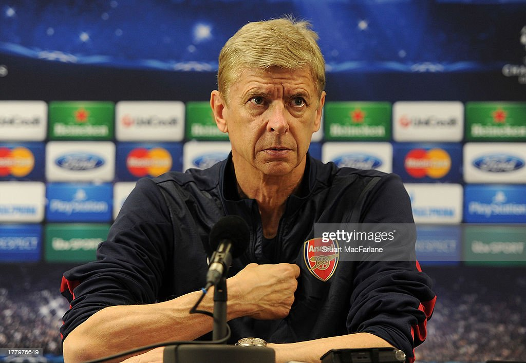 Arsenal manager <a gi-track='captionPersonalityLinkClicked' href=/galleries/search?phrase=Arsene+Wenger&family=editorial&specificpeople=171184 ng-click='$event.stopPropagation()'>Arsene Wenger</a> attends a press conference ahead of their UEFA Champions League Play Off second leg match against Fenerbache at London Colney on August 26, 2013 in St Albans, England.
