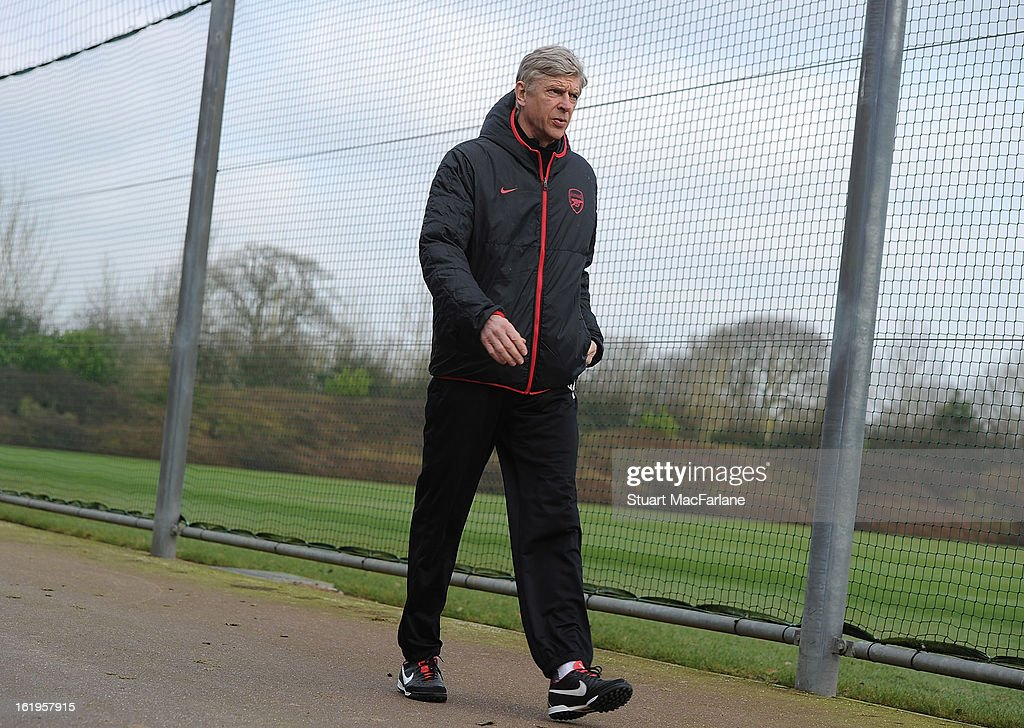 Arsenal manager Arsene Wenger attends a training session ahead of their UEFA Champions League match against FC Bayern Muenchen at London Colney on February 18, 2013 in St Albans, England.