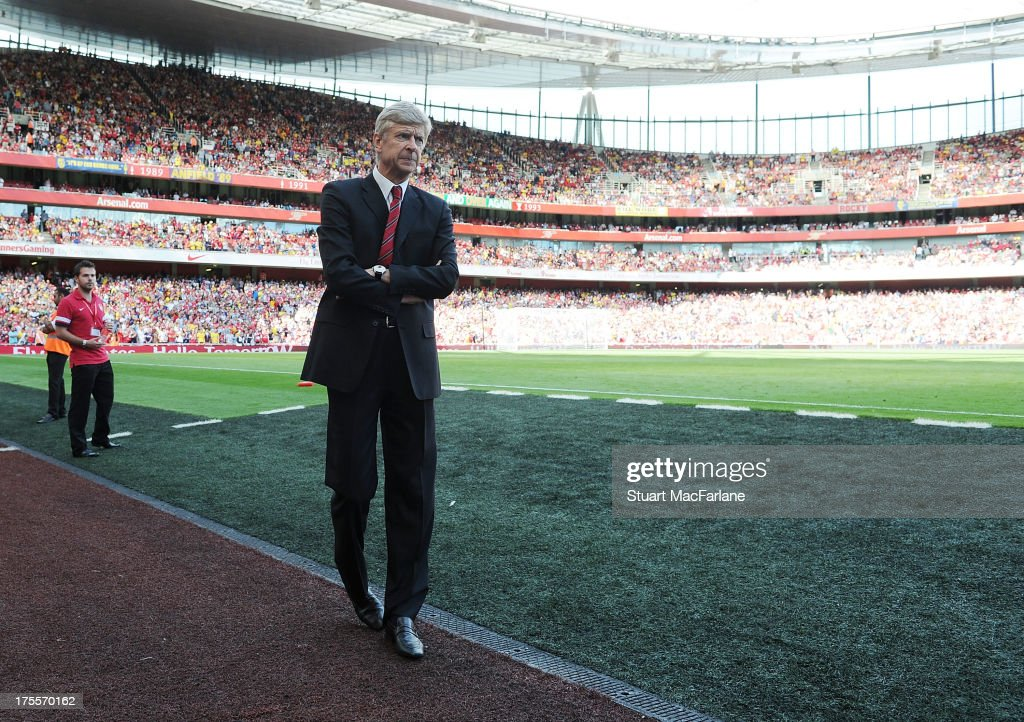 Arsenal manager <a gi-track='captionPersonalityLinkClicked' href=/galleries/search?phrase=Arsene+Wenger&family=editorial&specificpeople=171184 ng-click='$event.stopPropagation()'>Arsene Wenger</a> before the Emirates Cup match between Arsenal and Galatasaray at the Emirates Stadium on August 04, 2013 in London, England.