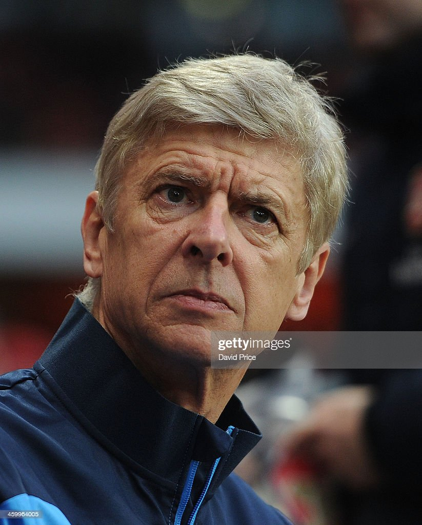 Arsenal Manager <a gi-track='captionPersonalityLinkClicked' href=/galleries/search?phrase=Arsene+Wenger&family=editorial&specificpeople=171184 ng-click='$event.stopPropagation()'>Arsene Wenger</a> before the match Arsenal against Cardiff City in the Barclays Premier League at Emirates Stadium on January 1, 2014 in London, England.