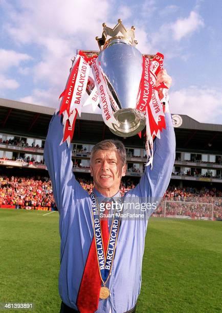 Arsenal manager Arsene Wenger celebrates after winning the Premier League Arsenal Stadium Highbury on May 15 2004 in London England
