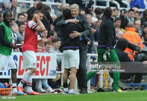 Arsenal manager Arsene Wenger celebrates at the end of the match during the Barclays Premier League match at St James' Park Newcastle