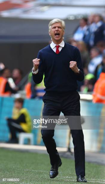 Arsenal manager Arsene Wenger celebrates they win during The Emirates FA Cup SemiFinal match between Arsenal and Manchester City at Wembley Stadium...
