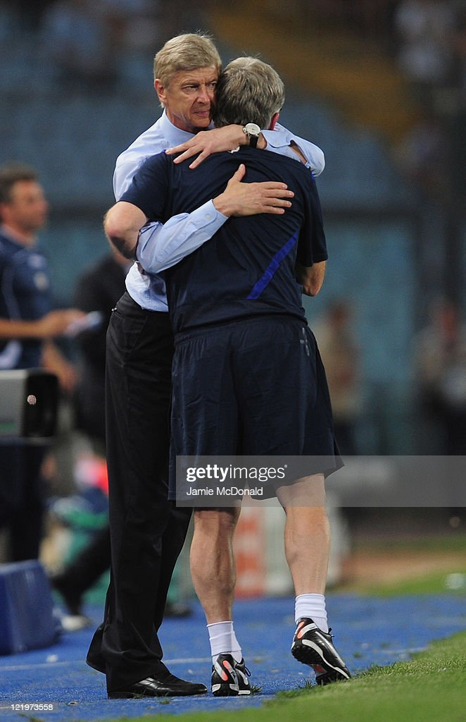 Arsenal manager <a gi-track='captionPersonalityLinkClicked' href=/galleries/search?phrase=Arsene+Wenger&family=editorial&specificpeople=171184 ng-click='$event.stopPropagation()'>Arsene Wenger</a> celebrates victory during the UEFA Champions League play-off second leg match between Udinese Calcio and Arsenal FC at the Stadio Friuli on August 24, 2011 in Udine, Italy.