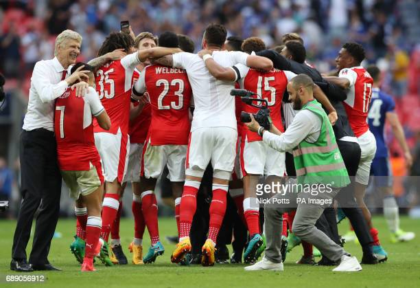 Arsenal manager Arsene Wenger celebrates with Arsenal's Alexis Sanchez after the final whistle during the Emirates FA Cup Final at Wembley Stadium...
