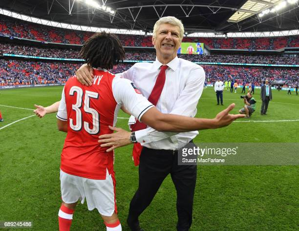 Arsenal manager Arsene Wenger celebrates with midfielder Mohamed Elneny after the Emirates FA Cup Final between Arsenal and Chelsea at Wembley...