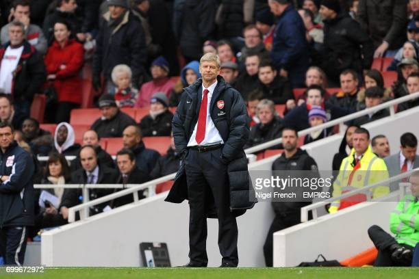 Arsenal manager Arsene Wenger dejected on the touchline as the final whistle blows