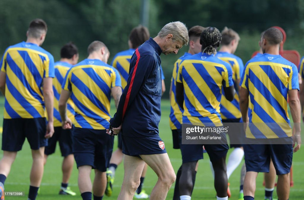 Arsenal manager <a gi-track='captionPersonalityLinkClicked' href=/galleries/search?phrase=Arsene+Wenger&family=editorial&specificpeople=171184 ng-click='$event.stopPropagation()'>Arsene Wenger</a> during a training session ahead of their UEFA Champions League Play Off second leg match against Fenerbache at London Colney on August 26, 2013 in St Albans, England.